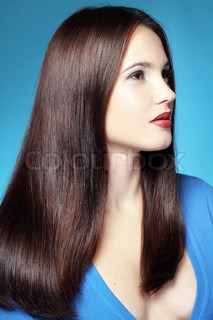 Portrait of young beautiful woman with long glossy hair
