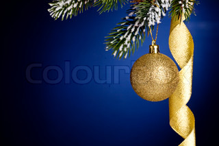 Border from Christmas tree branch and decorations on dark blue background
