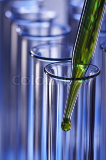 test tube with dropper on blue background