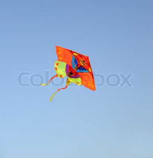 A colourful kite flying to the dark blue sky