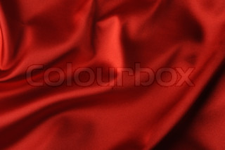 red satin background A satiny fabric with beautiful light-shadow waves
