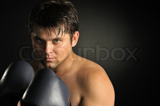 The young man in boxing gloves