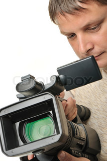 The man with a videocamera It is isolated on a white background