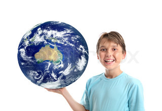 A smiling, cheerful boy holding our planet earth in the palm of his hand Earth showing mainly Australia, New Zealand and IndonesiaConcept, science education, environmental issues, travel destinations, asia pacific, oceania, etc