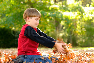 Image result for child holding leaves