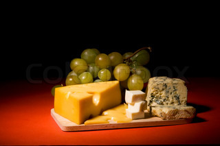 Wine, grapes and differentkinds of cheese still-life