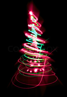 christmas tree form the color lights on the black background