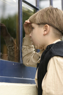 Child looking into an old storefronts window