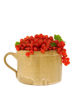 Ceramic cup full of fresh red currant berries. Clipping path included