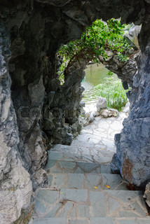 Mystery stone cave with pathway and staircase