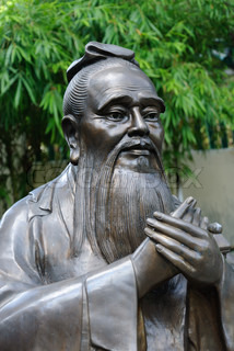 Chinese statue of Confucius with bamboo background