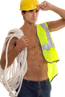 Construction worker carrying gear
