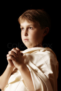 A boy in a simple robePleading, asking, begging, petitioning, praying, etc,