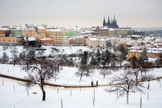 Prague castle in winter - town under snow