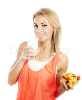 Pretty girl eating fruit salad and drinking milk, healthy fresh breakfast, dieting and health care concept