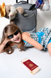 Little girl packed up in summer travel