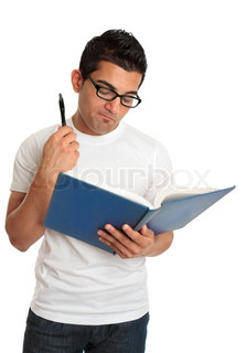 A man reading a hardcover book and thinking