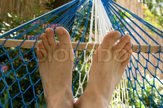 Hammock and feet, resting on the sun