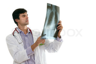 Doctor evaluating a patient's chest x-ray