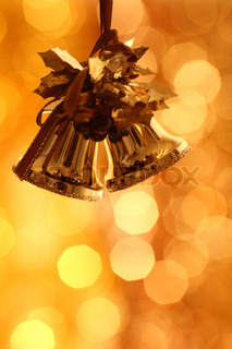Christmas bells against gold blurred background