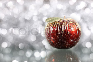 Christmas apple on silver blurred background