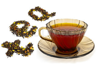Tea in a brown glass cup, the word tea from a mixture of black and green tea powder with petals of sunflower, rose, rose hips and papaya isolated on white background