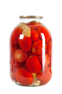 Preserved red tomatoes in a glass jar isolated on white background