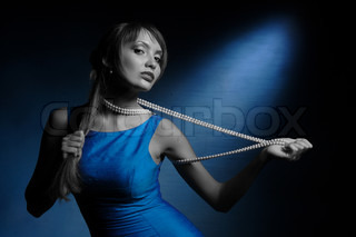 Girl with necklace in an erotic manner