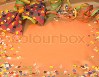colorful symbolic carnival and party background with decorative blow-out, bow tie and confetti