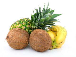ripe pineapple, bunch of bananas and coconut on a white background