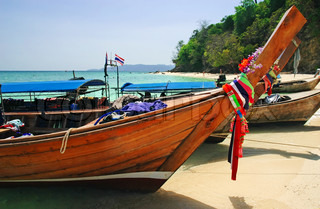 Traditional Thai wooden boats with flowers