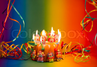 birthday cake with burning candles and decoration