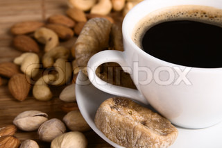 Closeup picture of coffee with nuts and dried fig still life