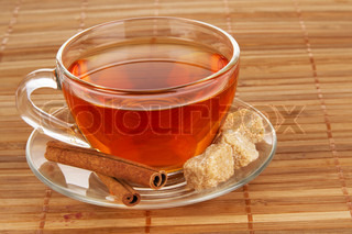 Tea with honey, lemon and cinnamon on bamboo pad