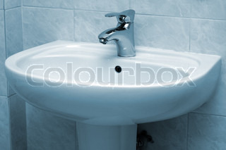 Water faucet and basin in blue tint
