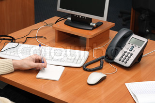 Desktop with a computer and an IP Phone on it