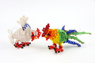 Color beaded cock and hen on white background