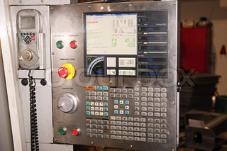 CNC Control panel and monitor at programmable machine