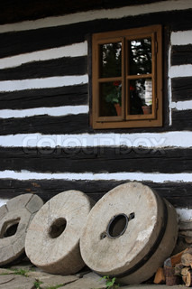 Timbered cottage and stone wheels, Czech Republic
