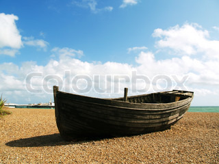 Old unusable boat on the beach