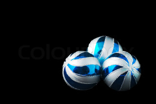 The blue Christmas balls on a black backbround