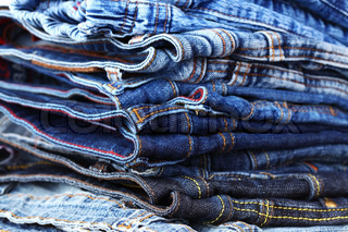 Stack of different jeans - detail