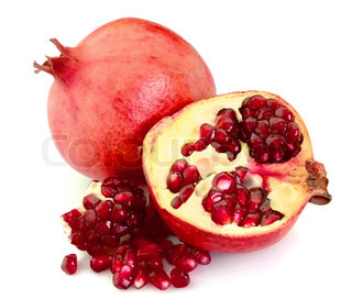 Pomegranate fruit and grains closeup