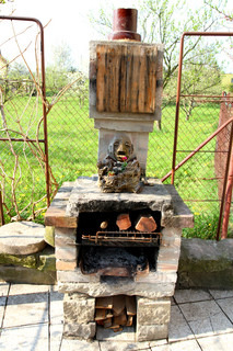 home made outdoor fireplace in the garden
