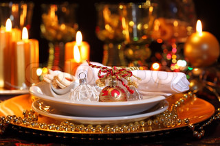 Luxury place setting in golden and whitefor Christmas