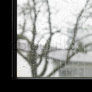 edge of a window and raindrops