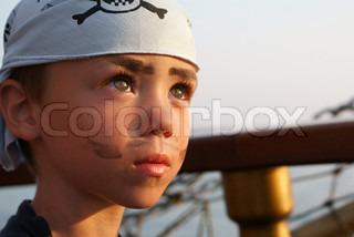 Portrait of little pirate on pirate's ship