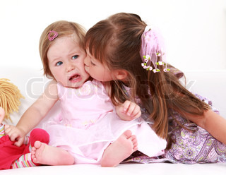 Kids giving a kiss to each other