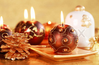 Christmas still life with candles and cookies in brown and golden tone