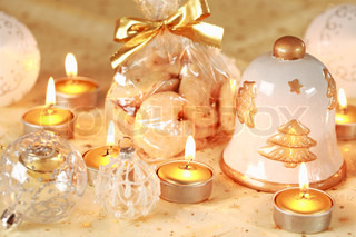 Christmas still life with candles and cookies in golden tone